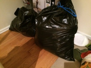 Two garbage bags full of clothes to donate thanks to KonMari!